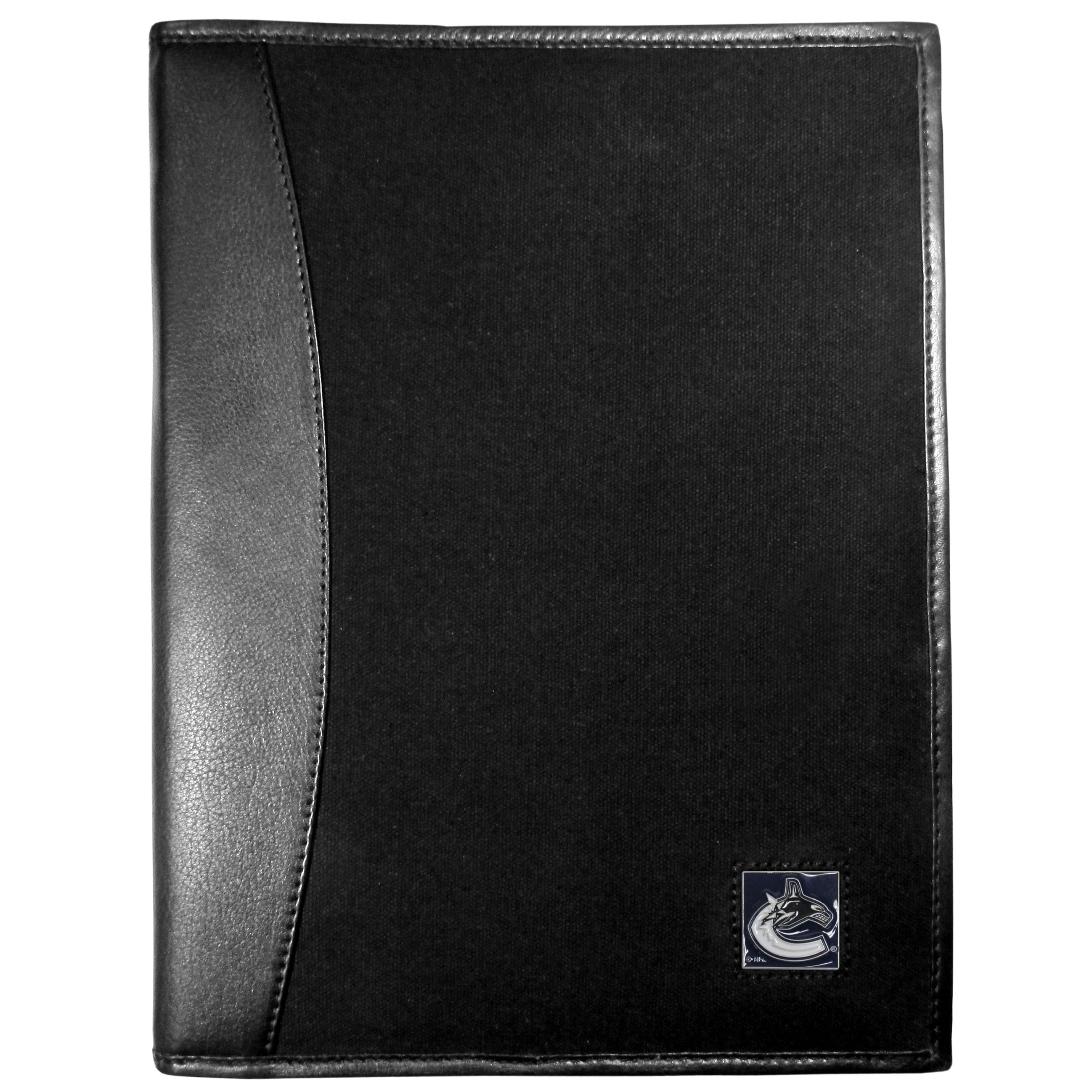 Vancouver Canucks® Leather and Canvas Padfolio - Our leather and canvas padfolio perfectly blends form and function. The attractive portfolio is bound in fine grain leather with an attractive canvas finish and the interior is a soft nylon. This high quality business accessory also features a fully cast metal Vancouver Canucks® emblem that is subtly set in the corner of the organizer. It is packed with features like 6 card slots for badges, business cards, hotel keys or credit cards and ID with a large pocket for loose papers and a writing tablet slot making it a must-have for the professional on the go.