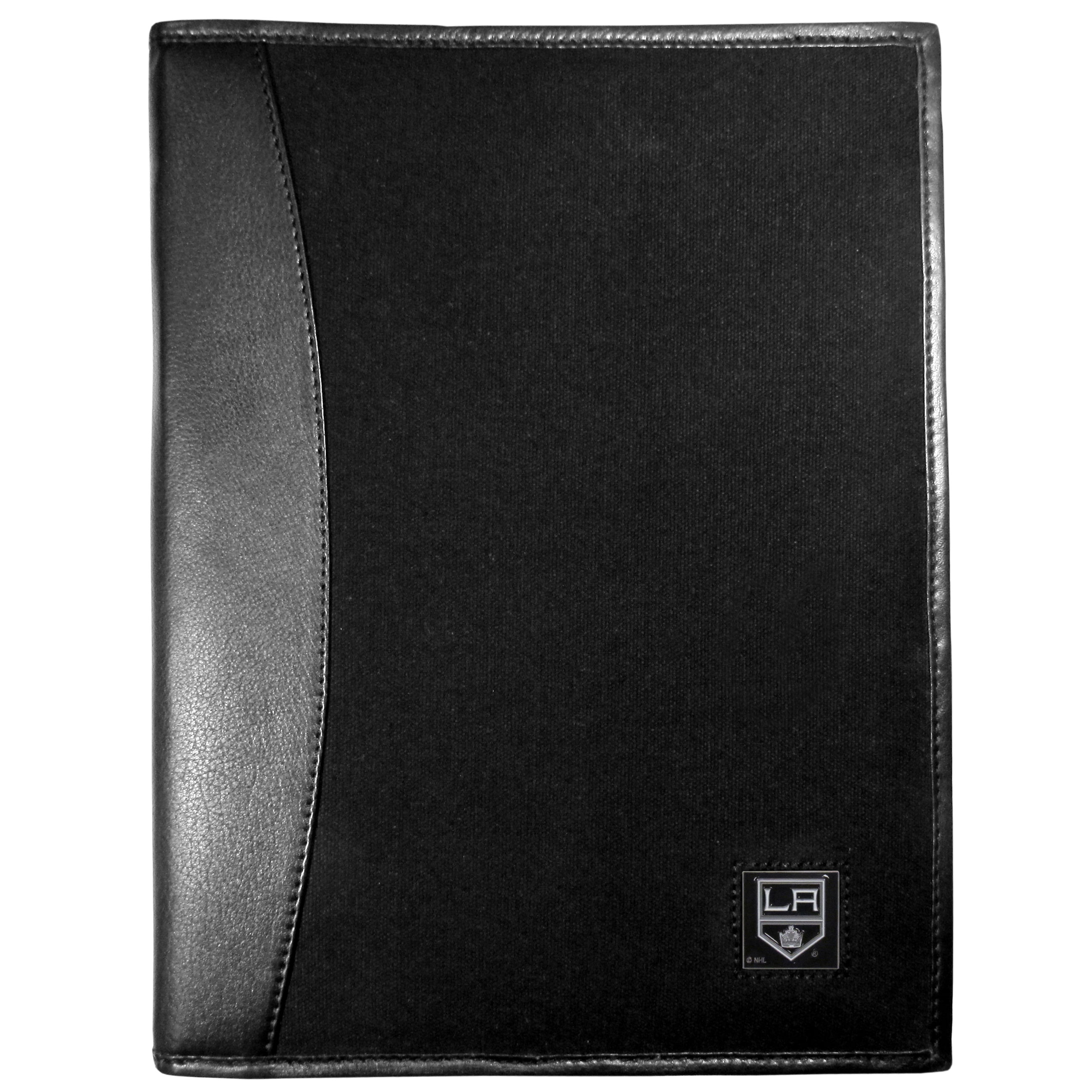 Los Angeles Kings® Leather and Canvas Padfolio - Our leather and canvas padfolio perfectly blends form and function. The attractive portfolio is bound in fine grain leather with an attractive canvas finish and the interior is a soft nylon. This high quality business accessory also features a fully cast metal Los Angeles Kings® emblem that is subtly set in the corner of the organizer. It is packed with features like 6 card slots for badges, business cards, hotel keys or credit cards and ID with a large pocket for loose papers and a writing tablet slot making it a must-have for the professional on the go.