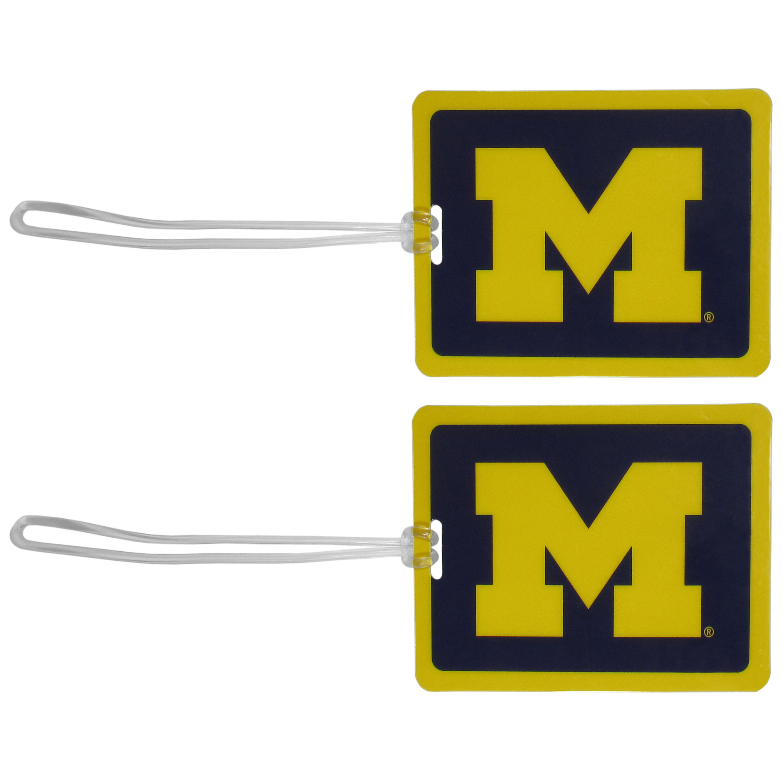Michigan Wolverines Vinyl Luggage Tag, 2pk - Tired of trying to spot your suitcase or bag in a sea of luggage? Try our large and colorful Michigan Wolverines luggage tags. The tag is 4x3 inches and has a 5 inch cord to attach it easily to your bags, backpacks or luggage. The front of the tag features the team logo in a bright, team colored background and you can write you name, address and phone number on the back of the tag.