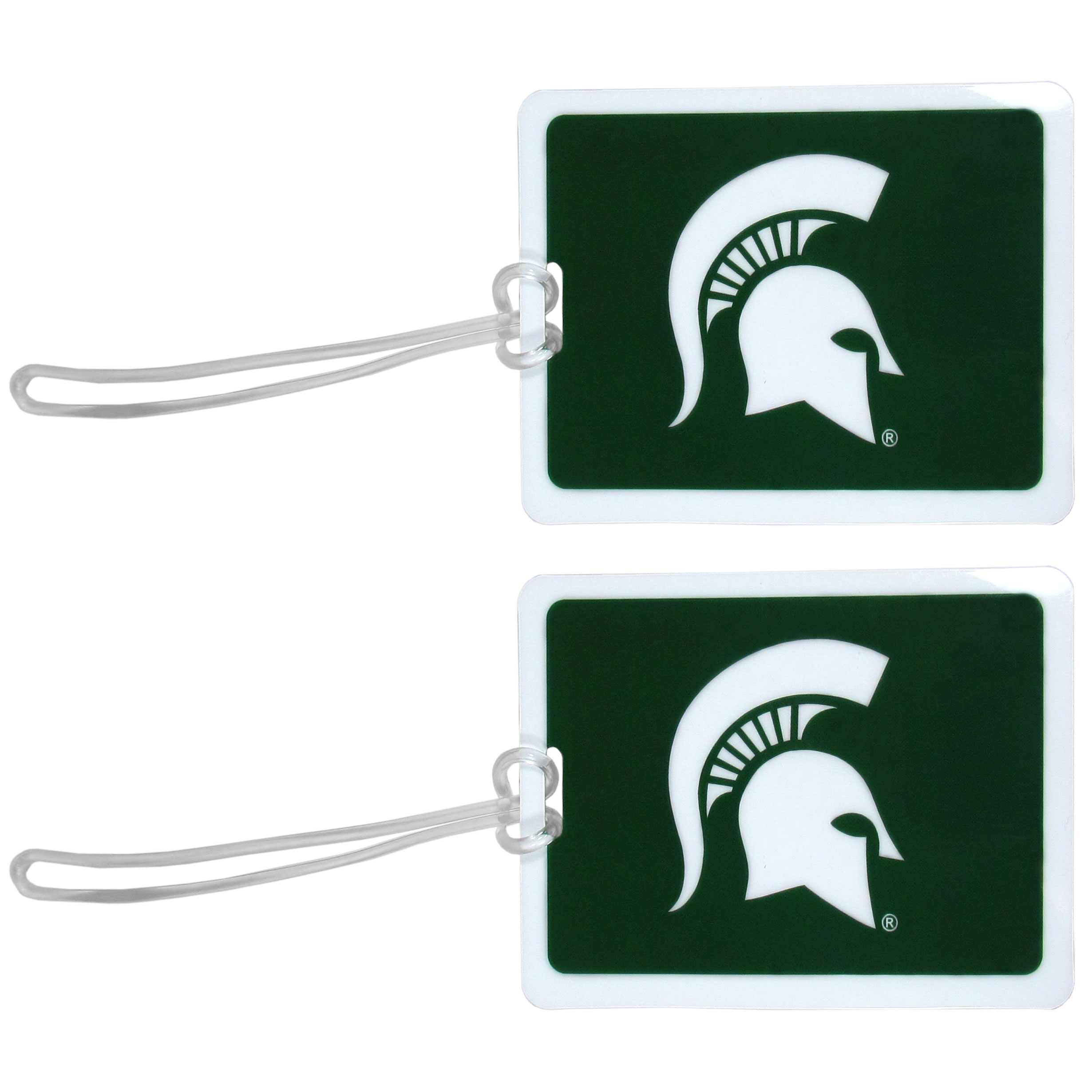 Michigan St. Spartans Vinyl Luggage Tag, 2pk - Tired of trying to spot your suitcase or bag in a sea of luggage? Try our large and colorful Michigan St. Spartans luggage tags. The tag is 4x3 inches and has a 5 inch cord to attach it easily to your bags, backpacks or luggage. The front of the tag features the team logo in a bright, team colored background and you can write you name, address and phone number on the back of the tag.
