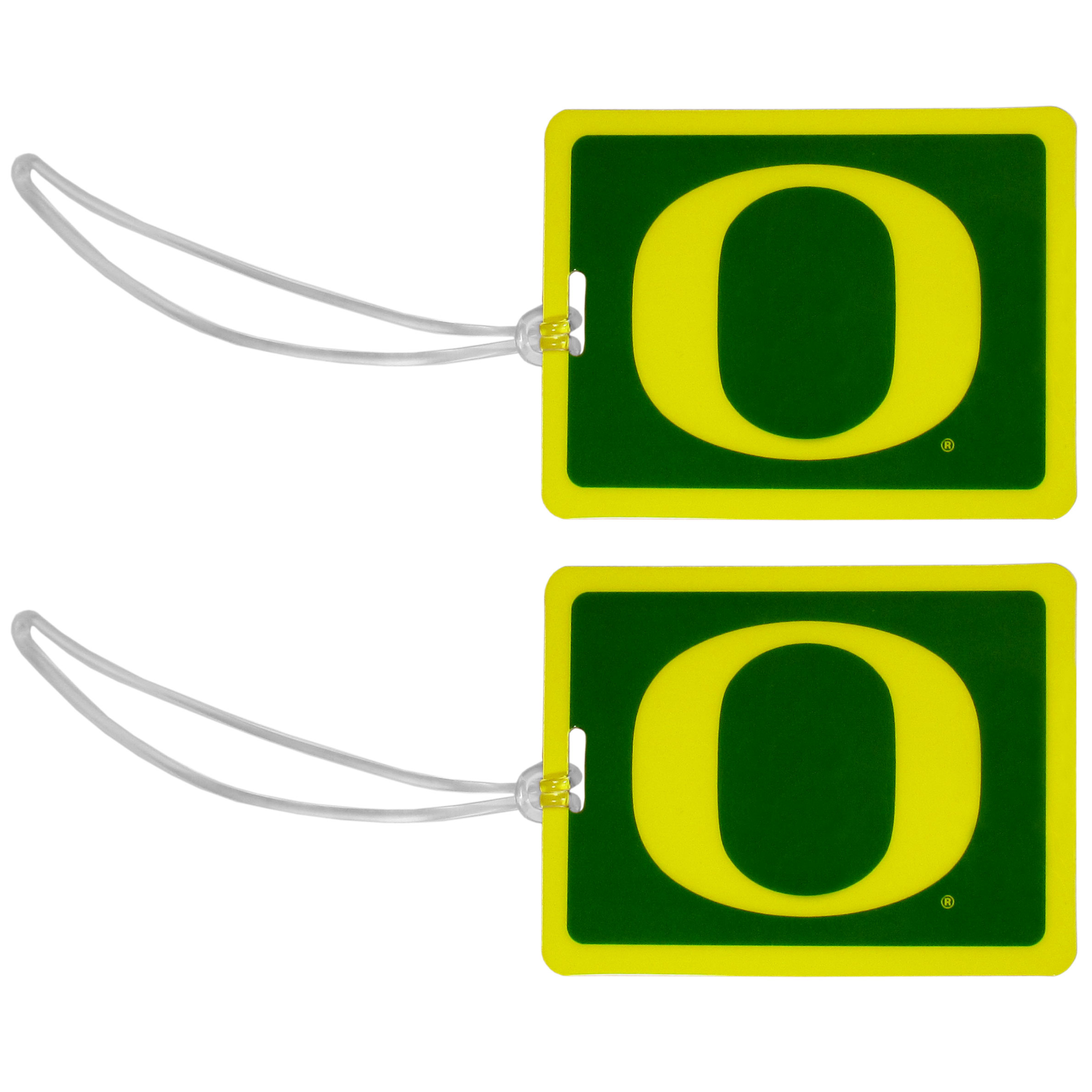 Oregon Ducks Vinyl Luggage Tag, 2pk - Tired of trying to spot your suitcase or bag in a sea of luggage? Try our large and colorful Oregon Ducks luggage tags. The tag is 4x3 inches and has a 5 inch cord to attach it easily to your bags, backpacks or luggage. The front of the tag features the team logo in a bright, team colored background and you can write you name, address and phone number on the back of the tag.