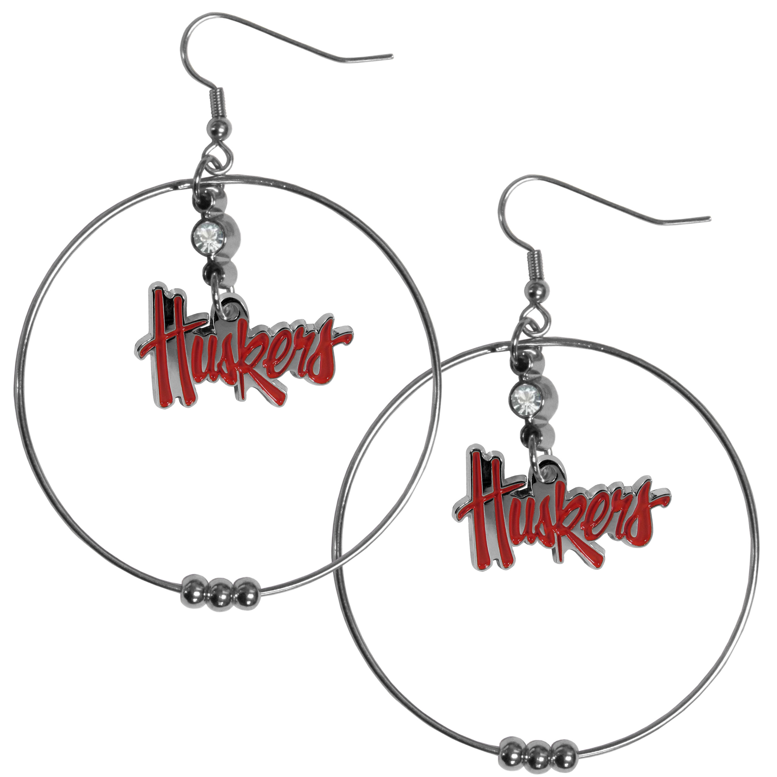 Nebraska Cornhuskers 2 Inch Hoop Earrings - Our large hoop earrings have a fully cast and enameled Nebraska Cornhuskers charm with enameled detail and a high polish nickel free chrome finish and rhinestone access. Hypoallergenic fishhook posts.