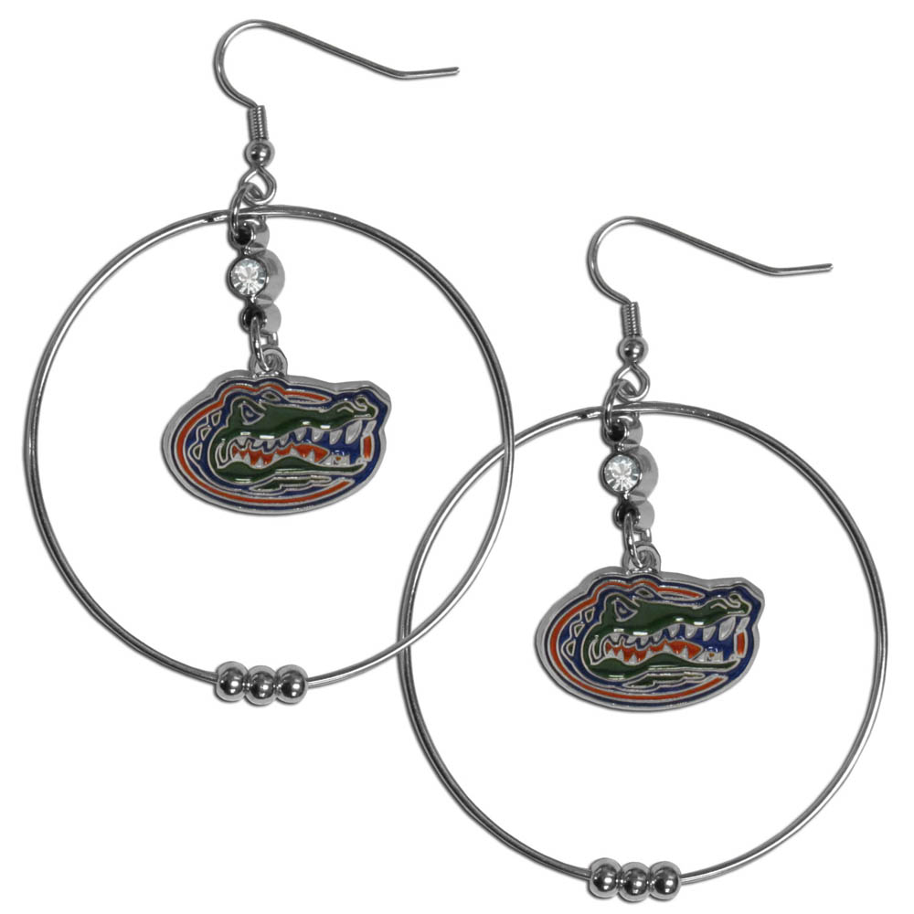 Florida Gators 2 Inch Hoop Earrings - Our large hoop earrings have a fully cast and enameled Florida Gators charm with enameled detail and a high polish nickel free chrome finish and rhinestone access. Hypoallergenic fishhook posts.