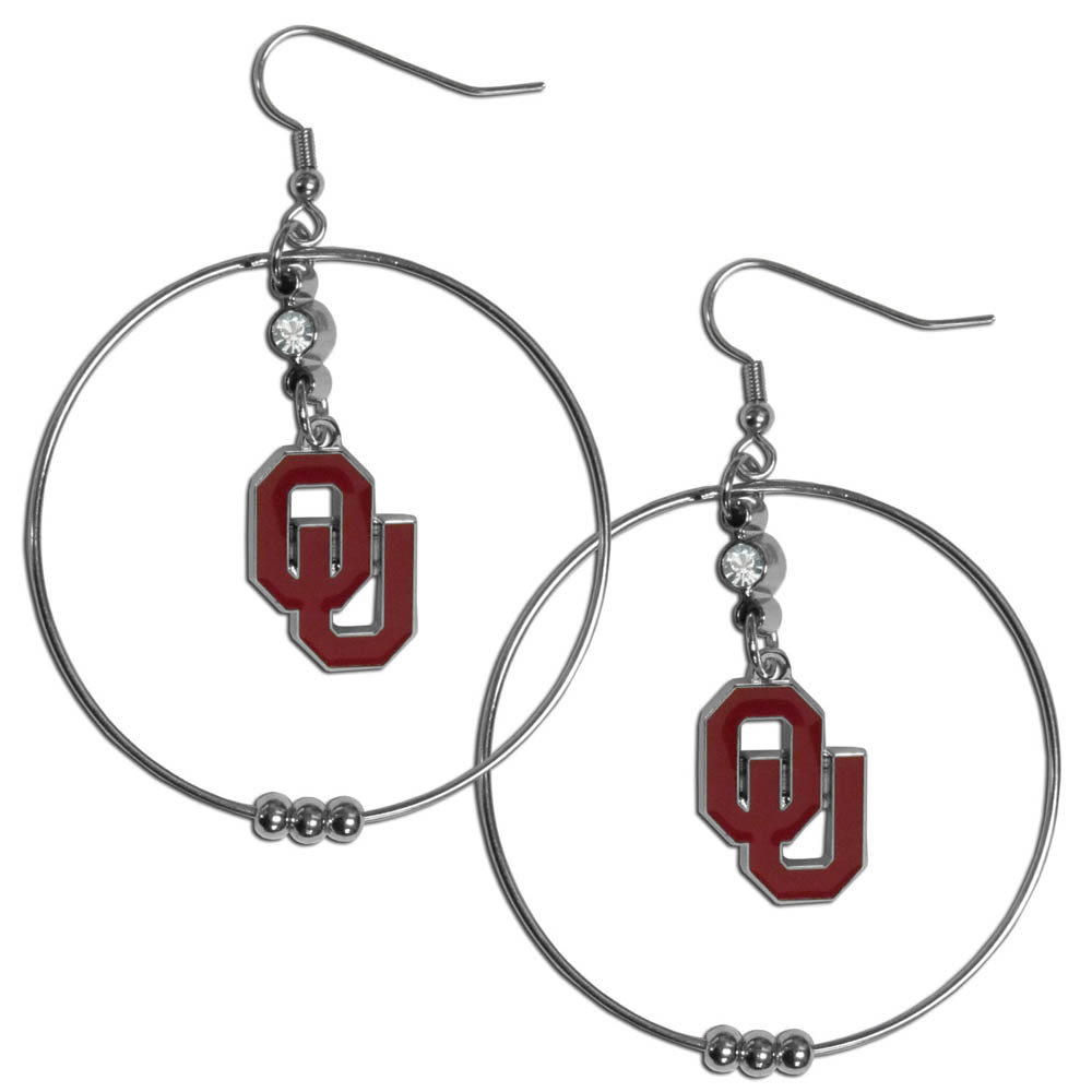Oklahoma Sooners 2 Inch Hoop Earrings - Our large hoop earrings have a fully cast and enameled Oklahoma Sooners charm with enameled detail and a high polish nickel free chrome finish and rhinestone access. Hypoallergenic fishhook posts.