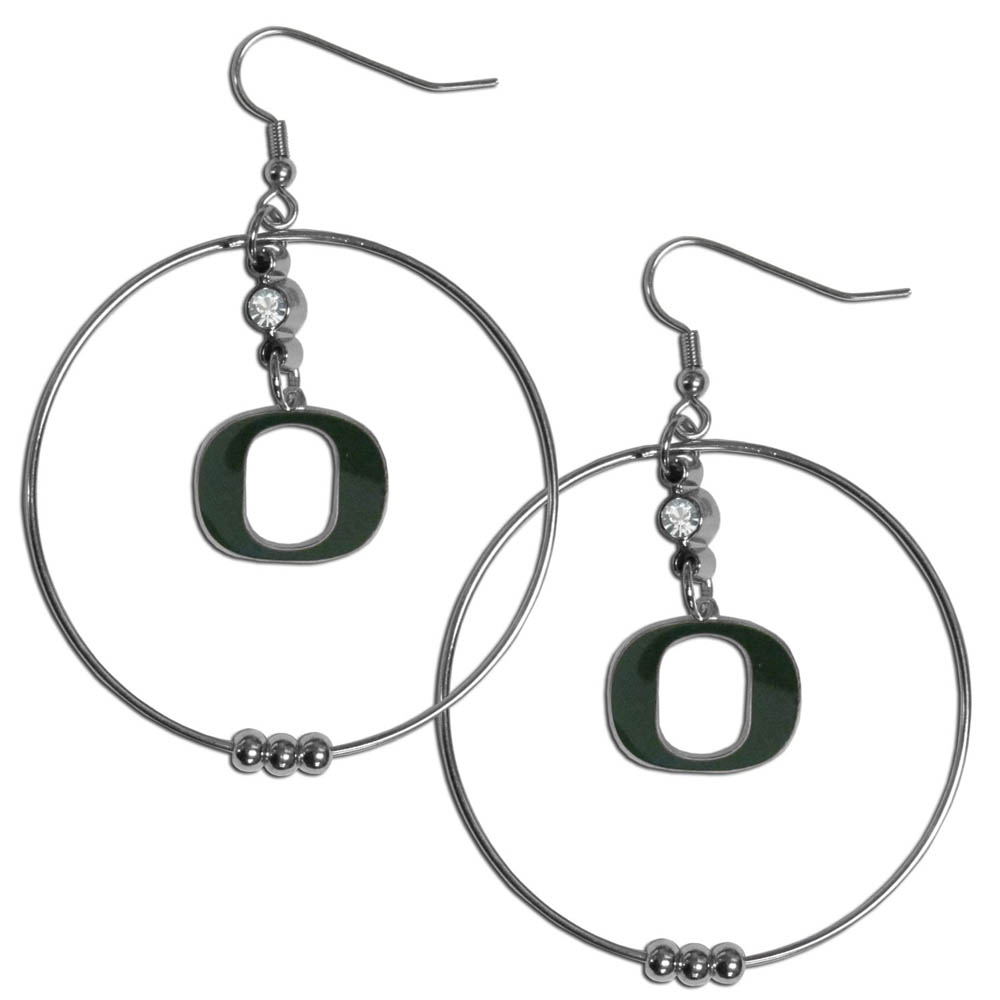 Oregon Ducks 2 Inch Hoop Earrings - Our large hoop earrings have a fully cast and enameled Oregon Ducks charm with enameled detail and a high polish nickel free chrome finish and rhinestone access. Hypoallergenic fishhook posts.