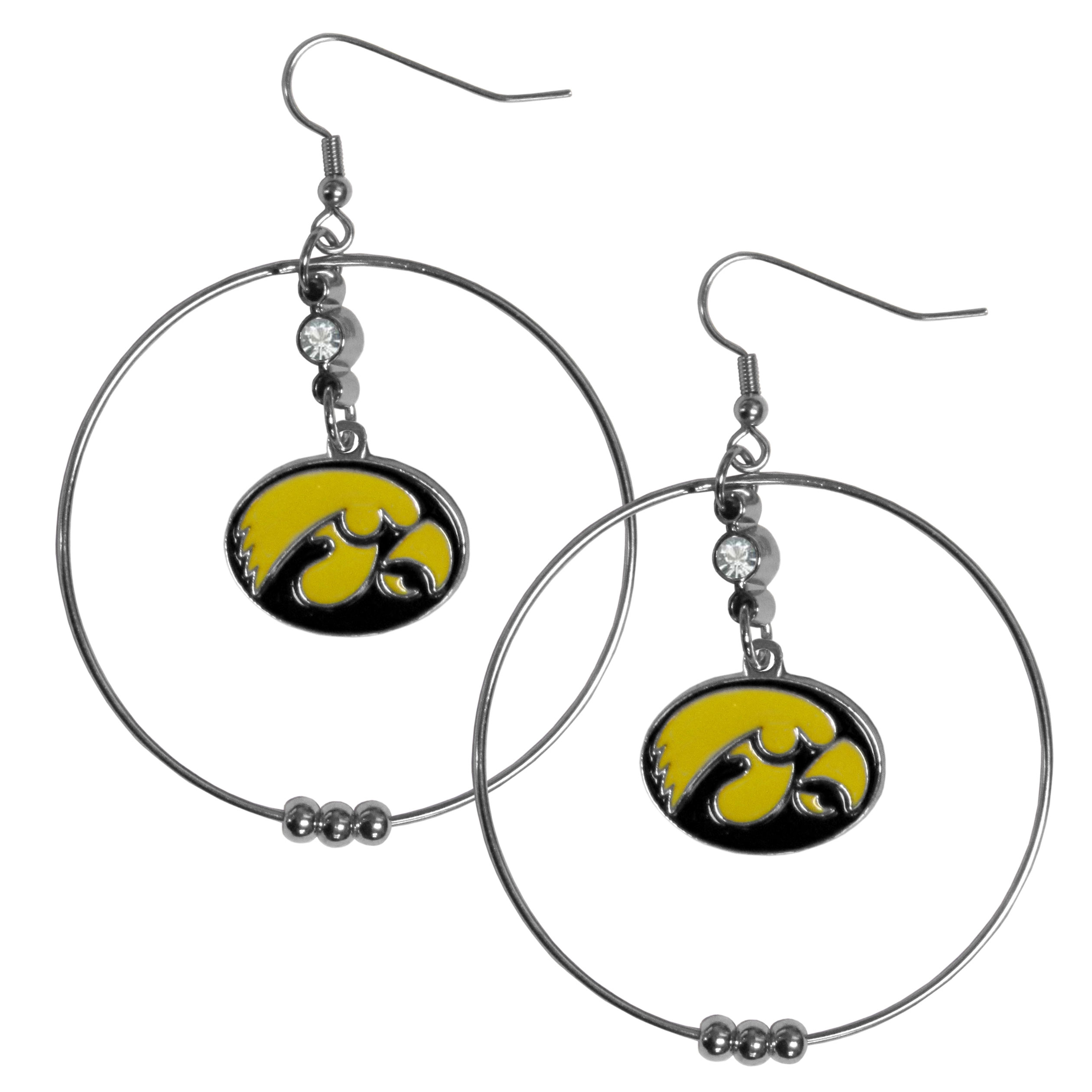 Iowa Hawkeyes 2 Inch Hoop Earrings - Our large hoop earrings have a fully cast and enameled Iowa Hawkeyes charm with enameled detail and a high polish nickel free chrome finish and rhinestone access. Hypoallergenic fishhook posts.