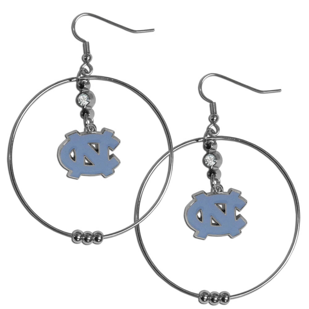 N. Carolina Tar Heels 2 Inch Hoop Earrings - Our large hoop earrings have a fully cast and enameled N. Carolina Tar Heels charm with enameled detail and a high polish nickel free chrome finish and rhinestone access. Hypoallergenic fishhook posts.