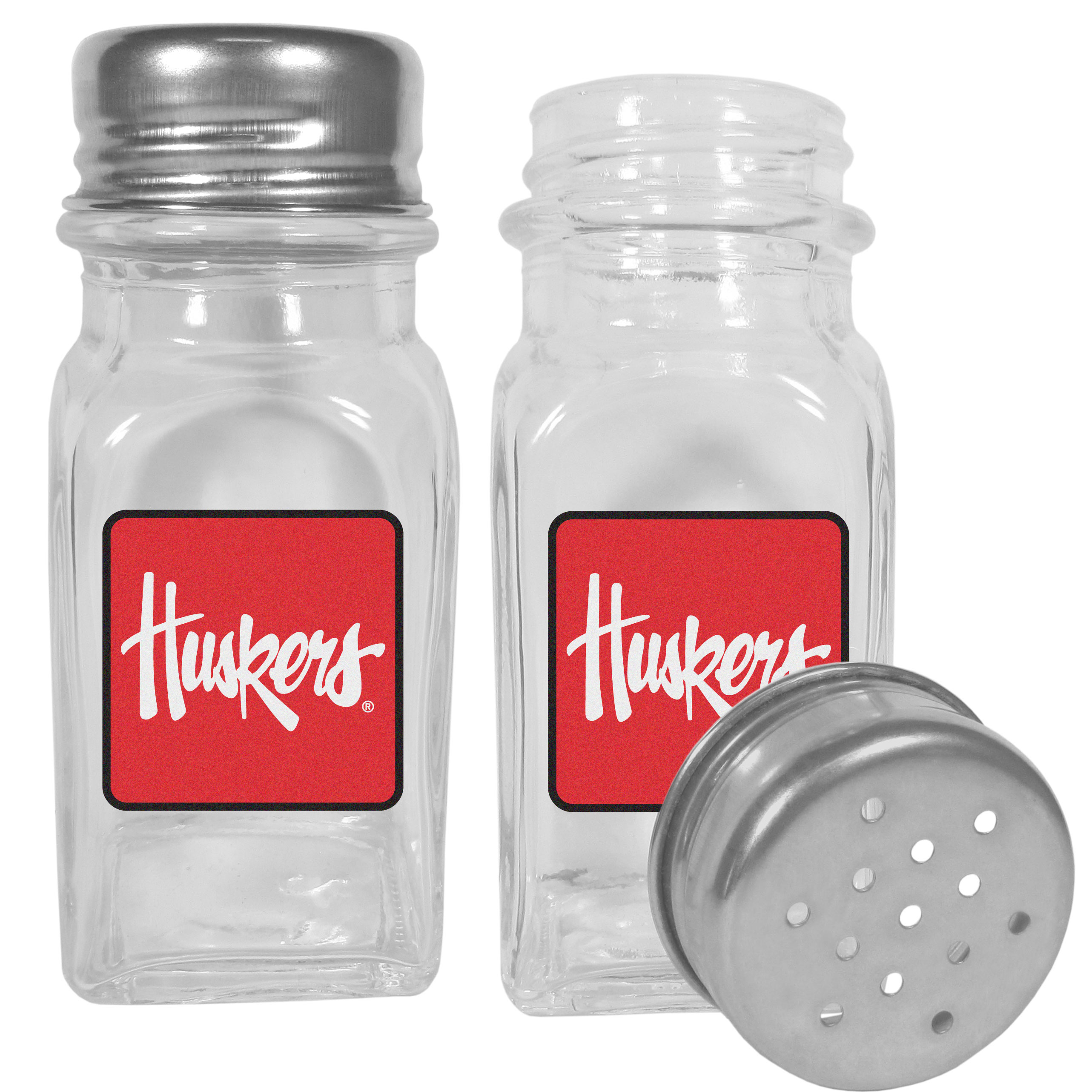 Nebraska Cornhuskers Graphics Salt & Pepper Shaker - No tailgate party is complete without your Nebraska Cornhuskers salt & pepper shakers featuring bright team logos. The diner replica salt and pepper shakers are glass with screw top lids. These team shakers are a great grill accessory whether you are barbecuing on the patio, picnicing or having a game day party.