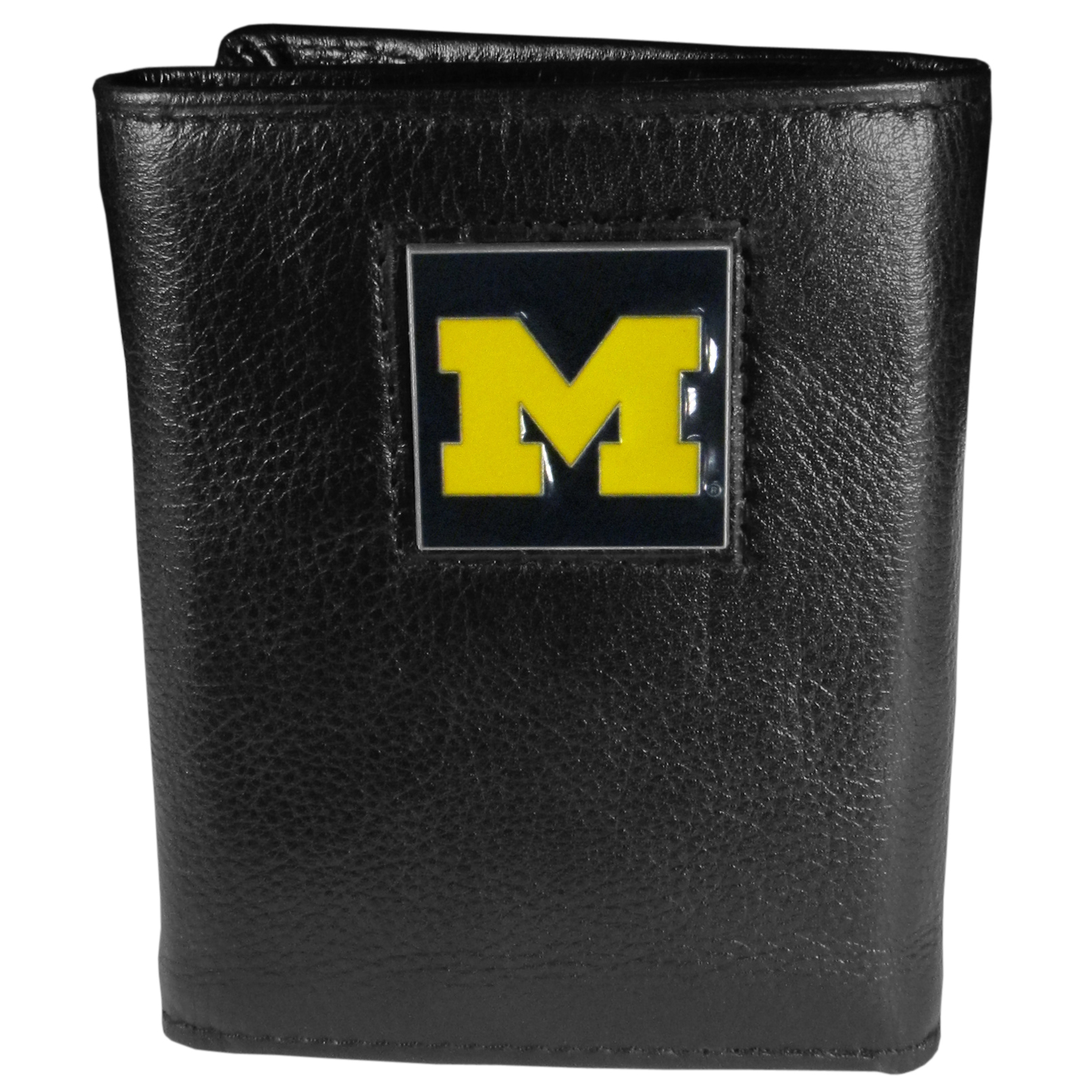Michigan Wolverines Leather Tri-fold Wallet - Our Michigan Wolverines leather tri-fold wallet features a sculpted and hand painted team square on a black leather tri-fold. Includes an ID window, slots for credit cards and clear plastic photo sleeves. For a sporty feel, the liner of the wallet is made with a canvas liner.