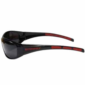 Arkansas Razorbacks Wrap Sunglasses - Our collegiate wrap style sports memorabilia sunglasses have the Arkansas Razorbacks school logo screen printed the frames. The sunglass arms feature rubber colored accents. UV 400 protection. Thank you for shopping with CrazedOutSports.com