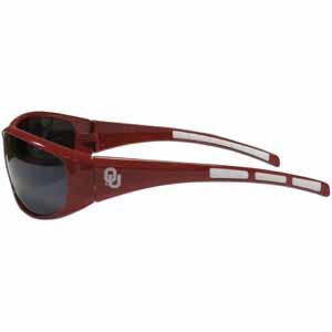 Oklahoma Wrap Sunglasses - Our collegiate wrap style sports memorabilia sunglasses have the school logo screen printed the frames. The sunglass arms feature rubber colored accents. UV 400 protection. Thank you for shopping with CrazedOutSports.com