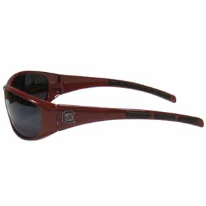 S. Carolina Wrap Sunglasses - Our collegiate wrap style sports memorabilia sunglasses have the school logo screen printed the frames. The sunglass arms feature rubber colored accents. UV 400 protection. Thank you for shopping with CrazedOutSports.com