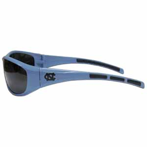 N. Carolina  Wrap Sunglasses - Our collegiate wrap style sports memorabilia sunglasses have the school logo screen printed the frames. The sunglass arms feature rubber colored accents. UV 400 protection. Thank you for shopping with CrazedOutSports.com