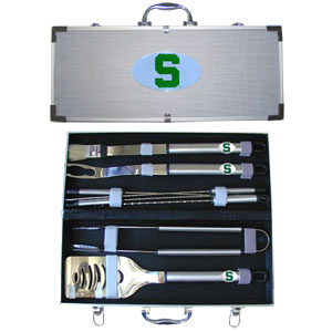 "Michigan St. Spartans College 8 pc BBQ Set  - Michigan St. Spartans College 8 pc BBQ Set includes a spatula with knife edge, grill fork, tongs, basting brush and 4 skewers. The Michigan St. Spartans College 8 pc BBQ Set tools are approximately 19"" long and have sturdy stainless steel handles. The aluminum carrying case features a metal carved emblem with enameled finish. Thank you for shopping with CrazedOutSports.com"