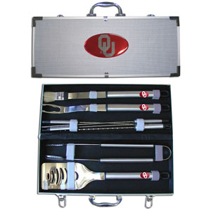 "College 8 pc BBQ Set - Oklahoma Sooners - Our collegiate 8 pc BBQ set includes a spatula with knife edge, grill fork, tongs, basting brush and 4 skewers. The tools are approximately 19"" long and have sturdy stainless steel handles. The aluminum carrying case features a metal carved emblem with enameled finish. Thank you for shopping with CrazedOutSports.com"