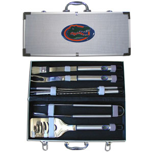 "College 8 pc BBQ Set - Florida Gators - Our collegiate 8 pc BBQ set includes a spatula with knife edge, grill fork, tongs, basting brush and 4 skewers. The tools are approximately 19"" long and have sturdy stainless steel handles. The aluminum carrying case features a metal carved Florida Gators emblem with enameled finish. Thank you for shopping with CrazedOutSports.com"