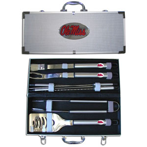 "Mississippi Rebels College Stainless Steel 8 pc BBQ Set - Our collegiate Mississippi Rebels College Stainless Steel 8 pc BBQ Setincludes a spatula with knife edge, grill fork, tongs, basting brush and 4 skewers. The tools are approximately 19"" long and have sturdy stainless steel handles. The aluminum carrying case features a metal carved emblem with enameled finish. Thank you for shopping with CrazedOutSports.com"