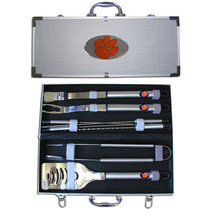 "College 8 pc BBQ Set - Clemson Tigers - Our collegiate 8 pc BBQ set includes a spatula with knife edge, grill fork, tongs, basting brush and 4 skewers. The tools are approximately 19"" long and have sturdy stainless steel handles. The aluminum carrying case features a metal carved Clemson Tigers emblem with enameled finish. Thank you for shopping with CrazedOutSports.com"
