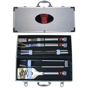 "College 8 pc BBQ Set - N. Carolina St. Wolfpack - Our collegiate 8 pc BBQ set includes a spatula with knife edge, grill fork, tongs, basting brush and 4 skewers. The tools are approximately 19"" long and have sturdy stainless steel handles. The aluminum carrying case features a metal carved emblem with enameled finish. Thank you for shopping with CrazedOutSports.com"