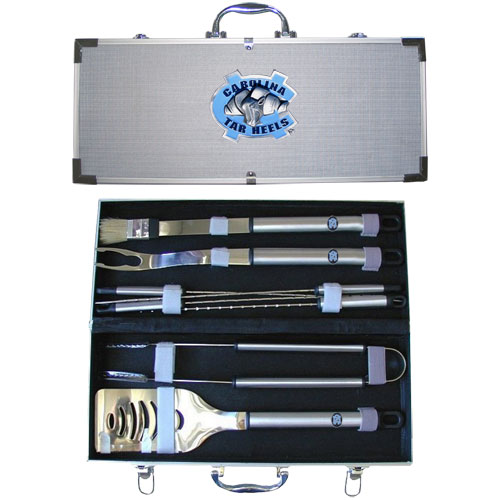 "College 8 pc BBQ Set - N. Carolina Tar Heels - Our collegiate 8 pc BBQ set includes a spatula with knife edge, grill fork, tongs, basting brush and 4 skewers. The tools are approximately 19"" long and have sturdy stainless steel handles. The aluminum carrying case features a metal carved emblem with enameled finish. Thank you for shopping with CrazedOutSports.com"