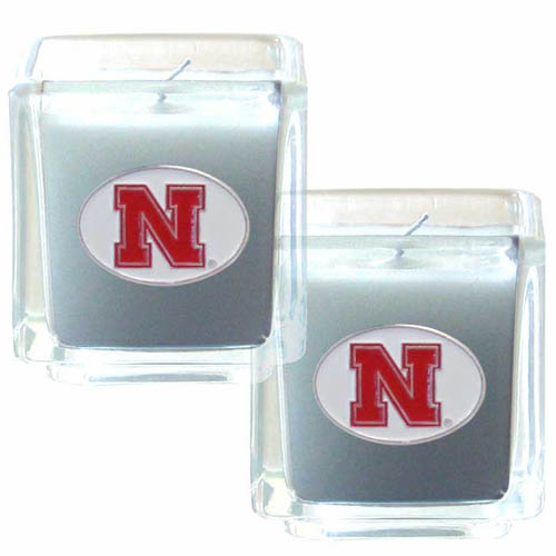 "College Candle Set (2) - Nebraska Cornhuskers - College Candle Set includes two 2"" x 2"" vanilla scented candles featuring a metal square with a hand enameled college emblem. Check out our extensive line of  collegiate merchandise! Thank you for shopping with CrazedOutSports.com"