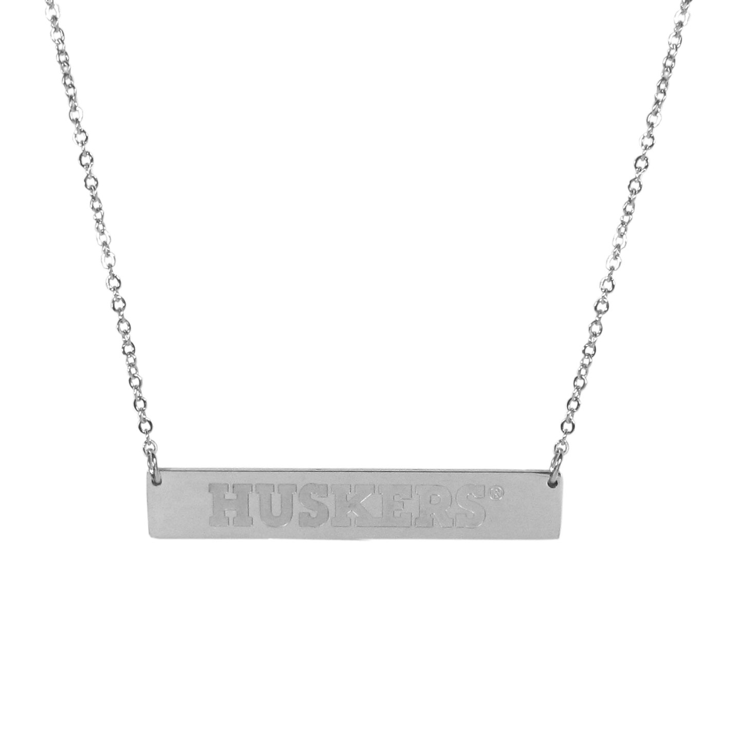 Nebraska Cornhuskers Bar Necklace - Simply beautiful Nebraska Cornhuskers bar necklace on a 20 inch link chain with 2 inch adjustable extender. This light-weight bar necklace has a stylish silver colored finish with the team name expertly etched on the 1.5 inch bar. Every female  fan will enjoy this contempory fashion accessory.
