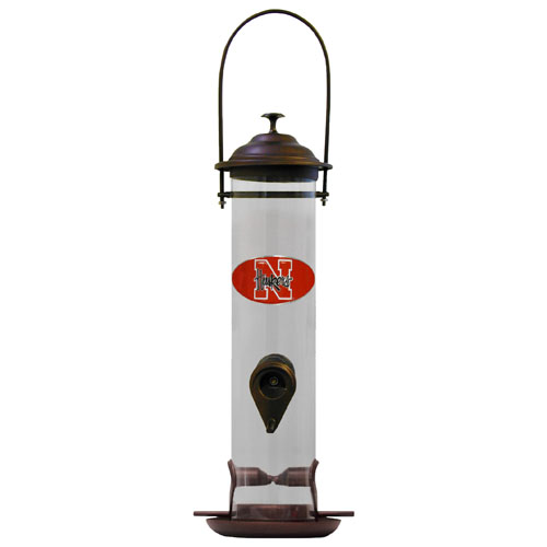 "Nebraska Bird Feeder - Our collegiate bird feeder is 18"" tall and has a 5"" diameter catcher tray and holds 24 ounces of feed. Easy to clean and fill. The feeder features a fully cast and enameled Nebraska Cornhuskers emblem. Thank you for shopping with CrazedOutSports.com"