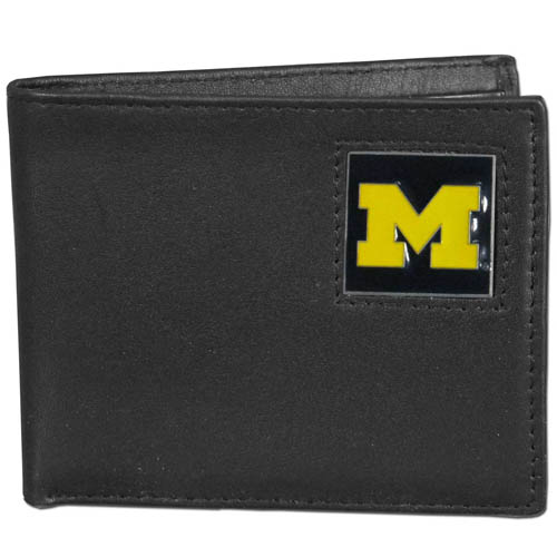Michigan Wolverines Leather Bifold Wallet - This college Michigan Wolverines Leather Bifold Wallet is made of high quality fine grain leather and includes credit card slots and photo sleeves. School logo is sculpted and enameled with fine detail on the front panel.  Thank you for shopping with CrazedOutSports.com