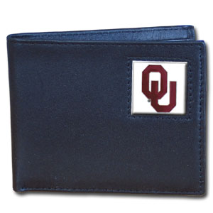 College Bi-fold Wallet Boxed - Oklahoma Sooners - Our  college Bi-fold wallet is made of high quality fine grain leather and includes credit card slots and photo sleeves. School logo is sculpted and enameled with fine detail on the front panel. Packaged in a window box. Thank you for shopping with CrazedOutSports.com