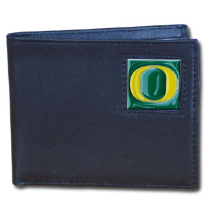 College Bi-fold Wallet Boxed - Oregon Ducks - Our  college Bi-fold wallet is made of high quality fine grain leather and includes credit card slots and photo sleeves. School logo is sculpted and enameled with fine detail on the front panel. Packaged in a window box. Thank you for shopping with CrazedOutSports.com