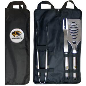 Missouri BBQ Set w/Bag - Our Missouri Tigers stainless steel 3 pc BBQ tool set includes a large spatula with built in bottle opener, heavy duty tongs, and large fork. All the tools feature a team logo on the handle. The set comes with a durable canvas bag that has a chrome accented team logo.  Thank you for shopping with CrazedOutSports.com