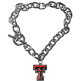 Texas Tech Raiders Charm Chain Bracelet - Our classic single charm bracelet is a great way to show off your team pride! The 7.5 inch large link chain features a high polish Texas Tech Raiders charm and features a toggle clasp which makes it super easy to take on and off.  Thank you for shopping with CrazedOutSports.com