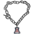 Arizona Wildcats Charm Chain Bracelet - Our classic single charm bracelet is a great way to show off your team pride! The 7.5 inch large link chain features a high polish Arizona Wildcats charm and features a toggle clasp which makes it super easy to take on and off.  Thank you for shopping with CrazedOutSports.com