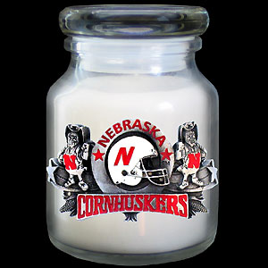 College Candle - Nebraska - Our lidded college candles are adorned by an expertly crafted, three-dimensional school emblem that is hand painted in team colors. Glass lid and holder. Candle is lightly scented with hint of vanilla. Thank you for shopping with CrazedOutSports.com