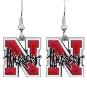 College Dangle Earrings - Nebraska Cornhuskers - Enameled zinc college logo earrings. A great way to show off your team spirit! Check out our entire licensed sports  jewelry line! Thank you for shopping with CrazedOutSports.com