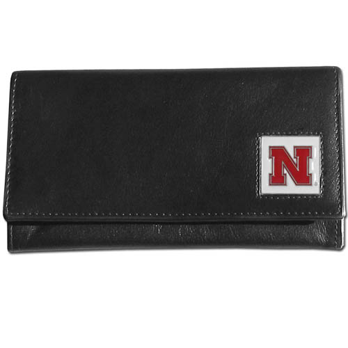 College Ladies Wallet - Nebraska Cornhuskers - This genuine leather women's pocketbook features 9 credit card slots, a windowed ID slot, spacious front pocket, inner pocket and zippered coin pocket. The front of the pocketbook has a hand painted metal square with the team's primary logo.  Thank you for shopping with CrazedOutSports.com