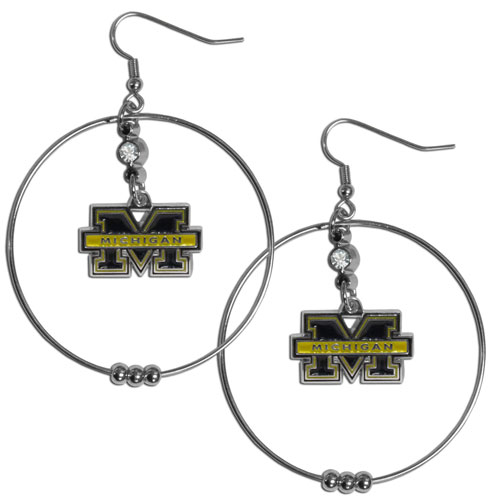 Michigan Wolverines 2 Inch Hoop Earrings - These officially licensed college Michigan Wolverines 2 Inch Hoop Earrings have a fully cast and enameled Michigan Wolverines emblem with enameled detail and a high polish nickel free chrome finish and rhinestone access. Michigan Wolverines 2 Inch Hoop Earrings has hypoallergenic fishhook posts. Thank you for shopping with CrazedOutSports.com