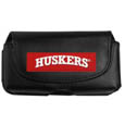 Nebraska Cornhuskers Smart Phone Pouch - Our smart phone pouch fits most phone styles and features a magnetic flip cover for easy access. The pouch has a clip with swivel head to easily attach the pouch to belts, backpacks or purses. Thank you for shopping with CrazedOutSports.com