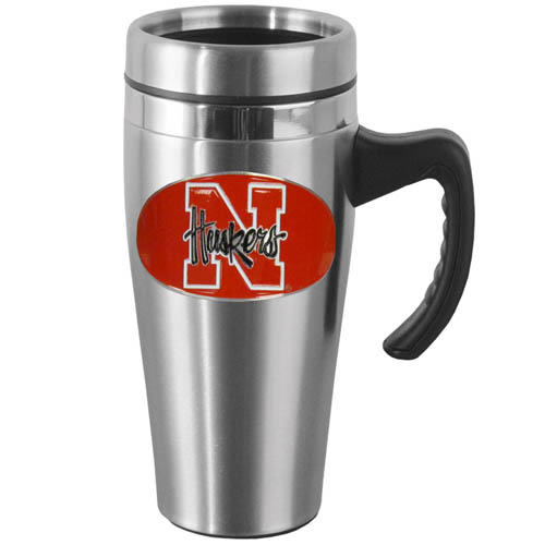 Nebraska Steel Mug w/Handle - Show off your school pride with this 14 oz stainless steel mug with brushed finish. The mug has a lid, handle and features a cast & enameled Nebraska Cornhuskers emblem. Thank you for shopping with CrazedOutSports.com