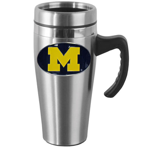 Michigan Wolverines Steel Mug w/Handle - Show off your school pride with this 14 oz stainless Michigan Wolverines Steel Mug w/Handle with brushed finish. The mug has a lid, handle and features a cast & enameled Michigan Wolverines emblem. Thank you for shopping with CrazedOutSports.com