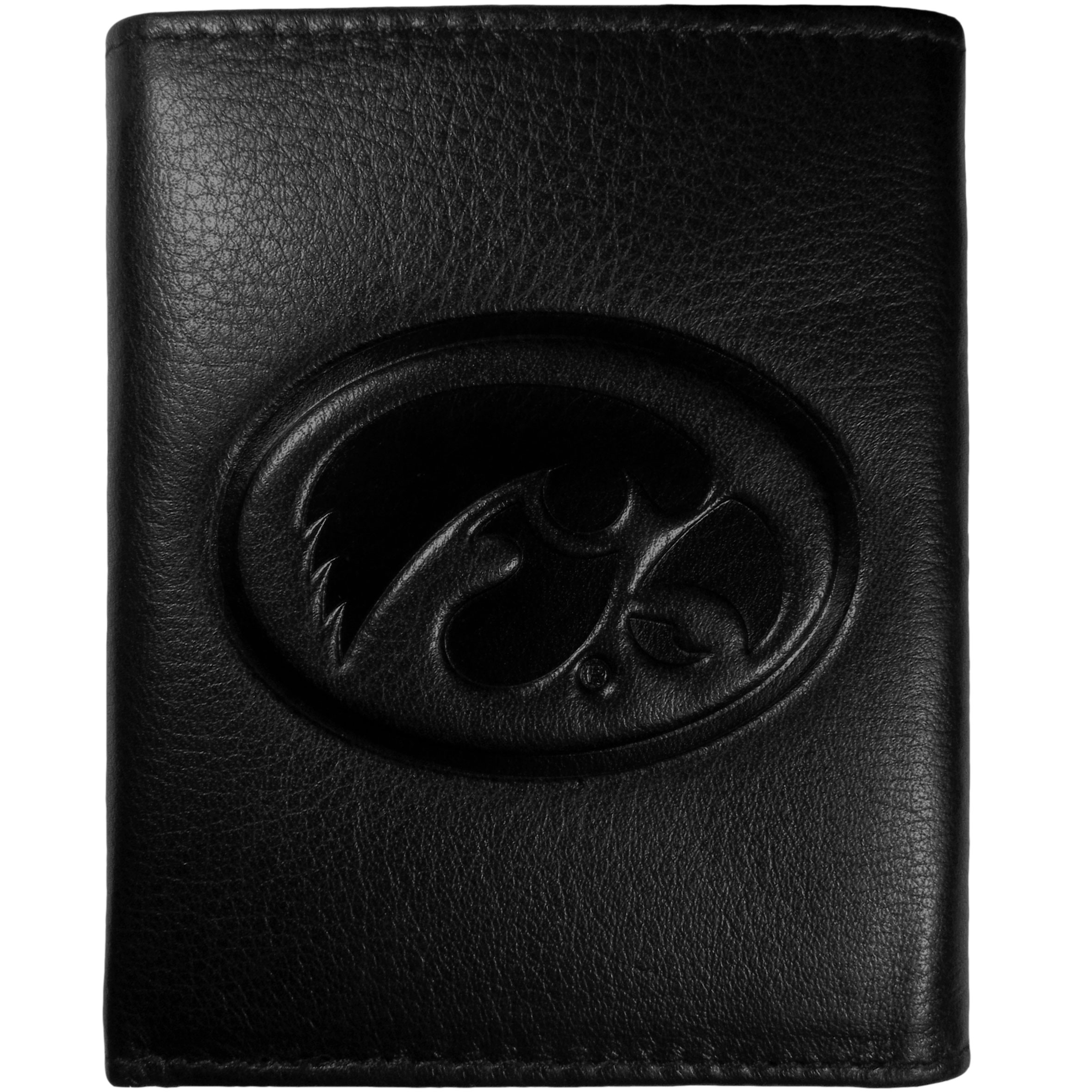Iowa Hawkeyes Embossed Leather Tri-fold Wallet - This stylish leather wallet is made of high quality leather with a supple feel and classic look. The front of the tri-fold style wallet has a deeply embossed Iowa Hawkeyes logo. The billfold is packed with features that will allow to keep organized, lots of credit card slots, windowed ID slot, large pockets for bills and a removable sleeve with extra slots for even more storage. This is a must-have men's fashion accessory that would make any fan very proud to own.
