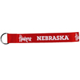Nebraska Cornhuskers  Lanyard Key Chain - Our wrist strap lanyard key chain is made of durable and comfortable woven material and is a not only a great key chain but an easy way to keep track of your keys. The bright Nebraska Cornhuskers graffics makes this key chain easy to find in gym bags, purses and in the dreaded couch cushions.