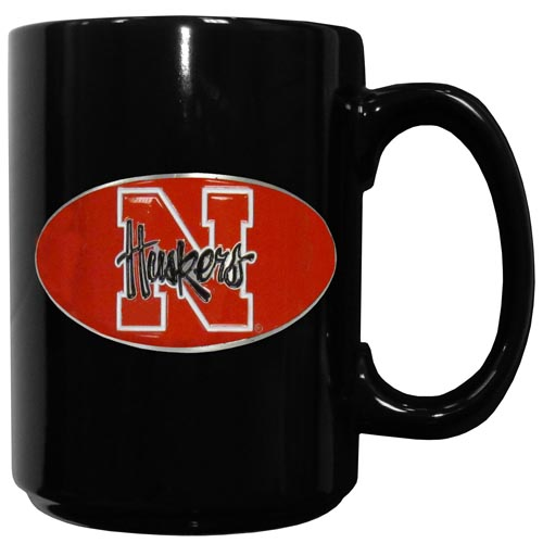 Nebraska Ceramic Coffee Mug - Our officiallly licensed college ceramic coffee mugs have an 11 oz capacity and feature a fully cast and hand enameled school emblem. Thank you for shopping with CrazedOutSports.com