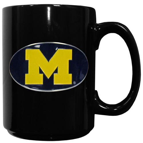Michigan Wolverines Ceramic Coffee Mug - This officiallly licensed college Michigan Wolverines Ceramic Coffee Mug has an 11 oz capacity and feature a fully cast and hand enameled school emblem. Thank you for shopping with CrazedOutSports.com