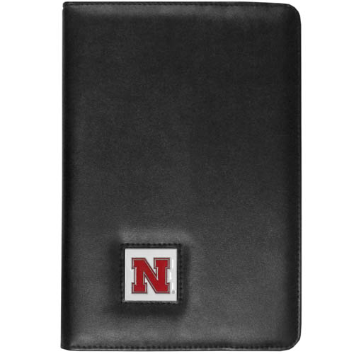 Nebraska iPad Mini Case - The perfect iPad mini accessory. The iPad mini slides easily into the inner sleeve that allows complete accessibility to all of the devices features and is the protected by the attractive out cover that can be secured closed or open while working with a simple stretch band. The great case features a cast and enameled college emblem. Thank you for shopping with CrazedOutSports.com