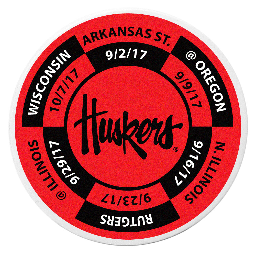 Nebraska Cornhuskers Schedule Golf Ball Marker Coin - Trick out your golf gear with our Nebraska Cornhuskers schedule coin that acts as a golf ball marker when on the links or a cool collector's item. The light weight coin features the teams football schedule in vivid team colors.