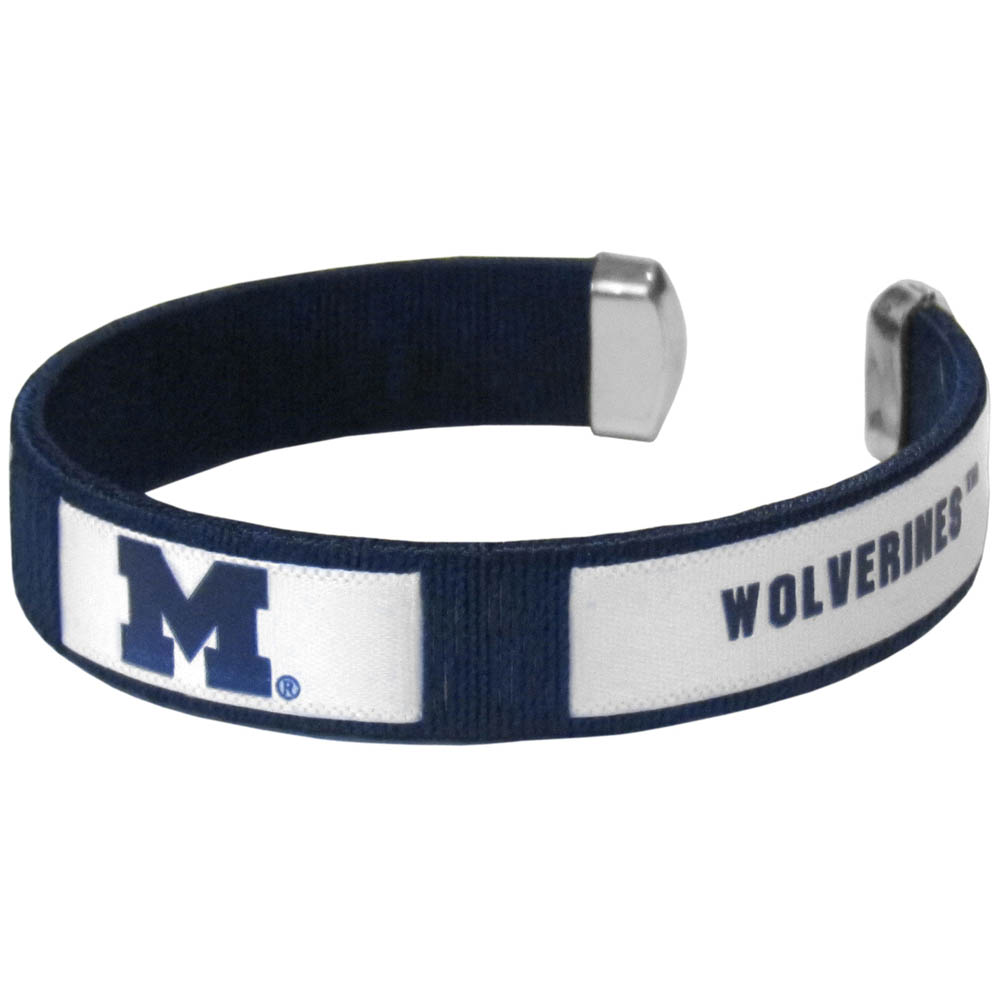 Michigan Wolverines Fan Bracelet - Our Fan Bracelet is a one size fits all string cuff bracelets with a screen printed ribbon with the team Michigan Wolverines name and logo.