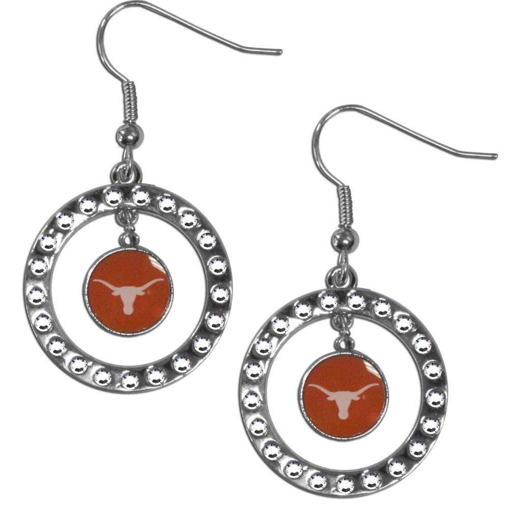 Texas Longhorns Rhinestone Hoop Earrings - Our officially licensed rhinestone hoop earrings comes on an hypo-allergenic fishhook posts  and features a hoop covered in rhinestones with a high polish chrome finish and a Texas Longhorns logo dangling in the center.