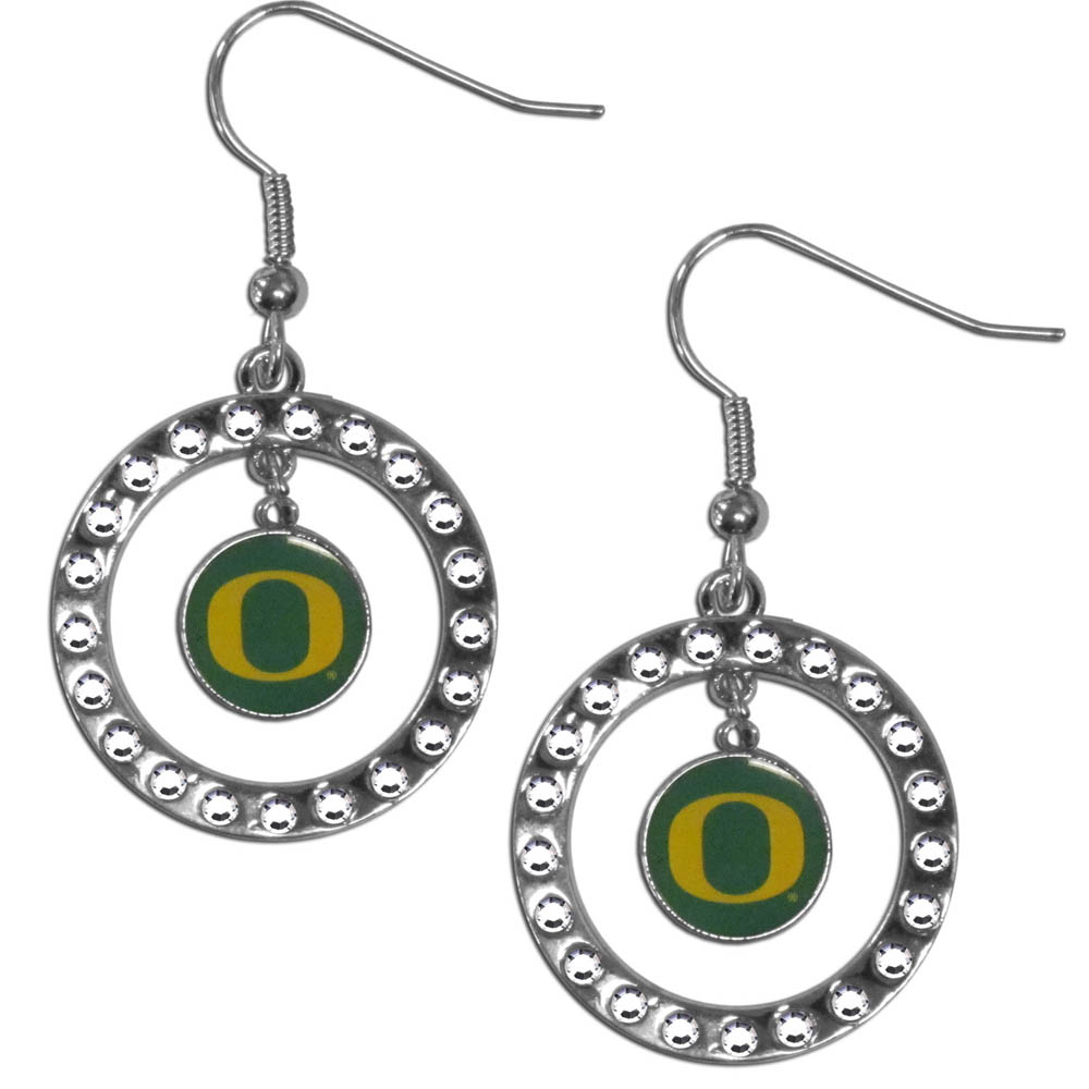 Oregon Ducks Rhinestone Hoop Earrings - Our officially licensed rhinestone hoop earrings comes on an hypo-allergenic fishhook posts  and features a hoop covered in rhinestones with a high polish chrome finish and a Oregon Ducks logo dangling in the center.