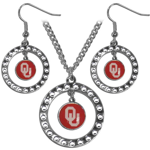 "Oklahoma Sooners Rhinestone Jewelry Set - This officially licensed collegiate jewelry set includes our rhinestone hoop earrings and pendant in an collegiate gift box. The 1"" rhinestone hoop pendant comes on an 18"" chain and is paired with the matching dangle hoop earrings. Thank you for shopping with CrazedOutSports.com"